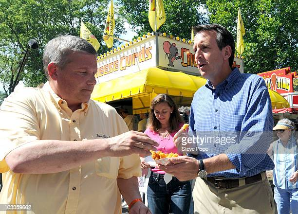 Minnesota Gov Tim Pawlenty offers Iowa Secretary of Agriculture Bill Northey some deep fried cheese curds at the Iowa State Fair August 12 2010 in...