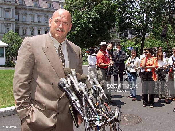 Minnesota Governor Jesse Ventura speaks to reporters 23 June 1999 at the White House in Washington DC Ventura said he met with Gene Sperling director...