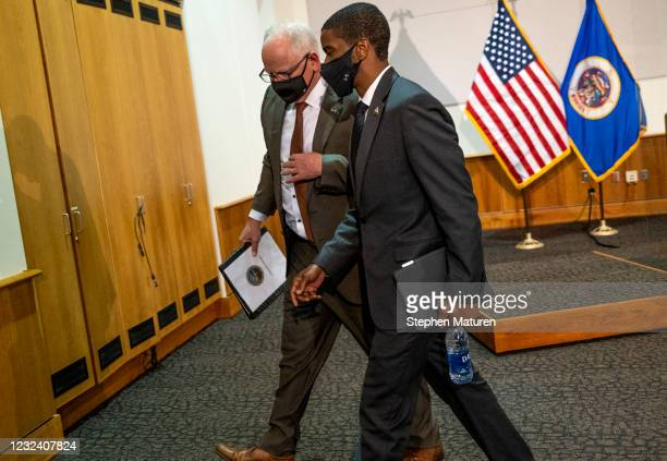 Minnesota Governor Tim Walz and St. Paul Mayor Melvin Carter walk out together after speaking at a press conference about public safety on April 19,...