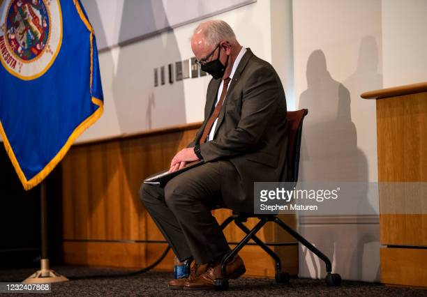Minnesota Governor Tim Walz listens as St. Paul Mayor Melvin Carter speaks during a press conference about public safety as the Derek Chauvin murder...