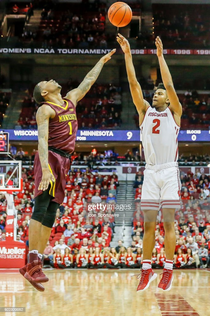 Minnesota guard Dupree McBrayer (1) tries to block a shot by Wisconsin forward Aleem Ford (2) during a college basketball game between the University of Wisconsin Badgers and the University of Minnesota Golden Gophers on February 19, 2018 at the Kohl Center in Madison, WI. Wisconsin defeated Minnesota by a score of 73 - 63.