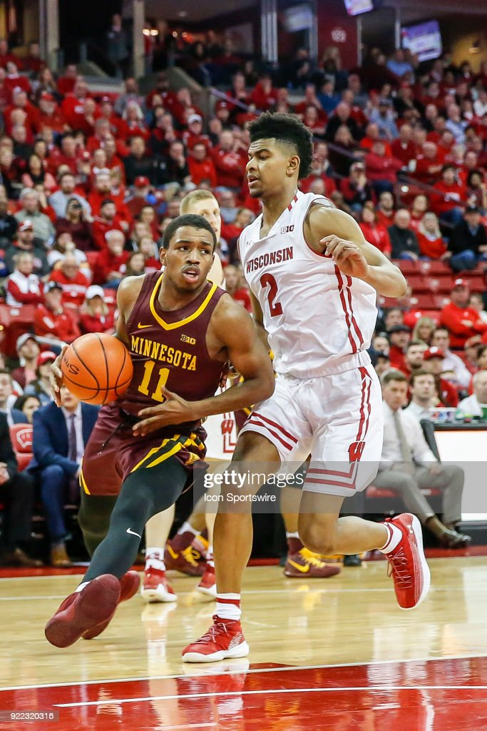 Minnesota guard Isaiah Washington (11) gets past Wisconsin forward Aleem Ford (2) during a college basketball game between the University of Wisconsin Badgers and the University of Minnesota Golden Gophers on February 19, 2018 at the Kohl Center in Madison, WI. Wisconsin defeated Minnesota by a score of 73 - 63.