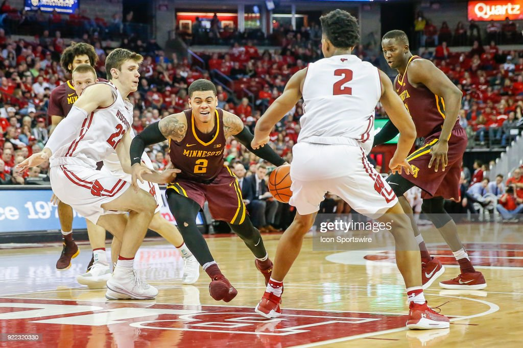 Minnesota guard Nate Mason (2) drives to the basket in between Wisconsin forwards Ethan Happ (22) and Aleem Ford (2) during a college basketball game between the University of Wisconsin Badgers and the University of Minnesota Golden Gophers on February 19, 2018 at the Kohl Center in Madison, WI. Wisconsin defeated Minnesota by a score of 73 - 63.