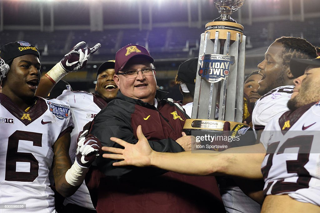 Minnesota head coach Tracy Claeys holds up the Holiday Bowl trophy to and celebrates the victory during the National Funding Holiday Bowl game between the Minnesota Golden Gophers and the Washington State Cougars on December 27, 2016, at Qualcomm Stadium in San Diego, CA. Minnesota defeated Washington State 17-12.