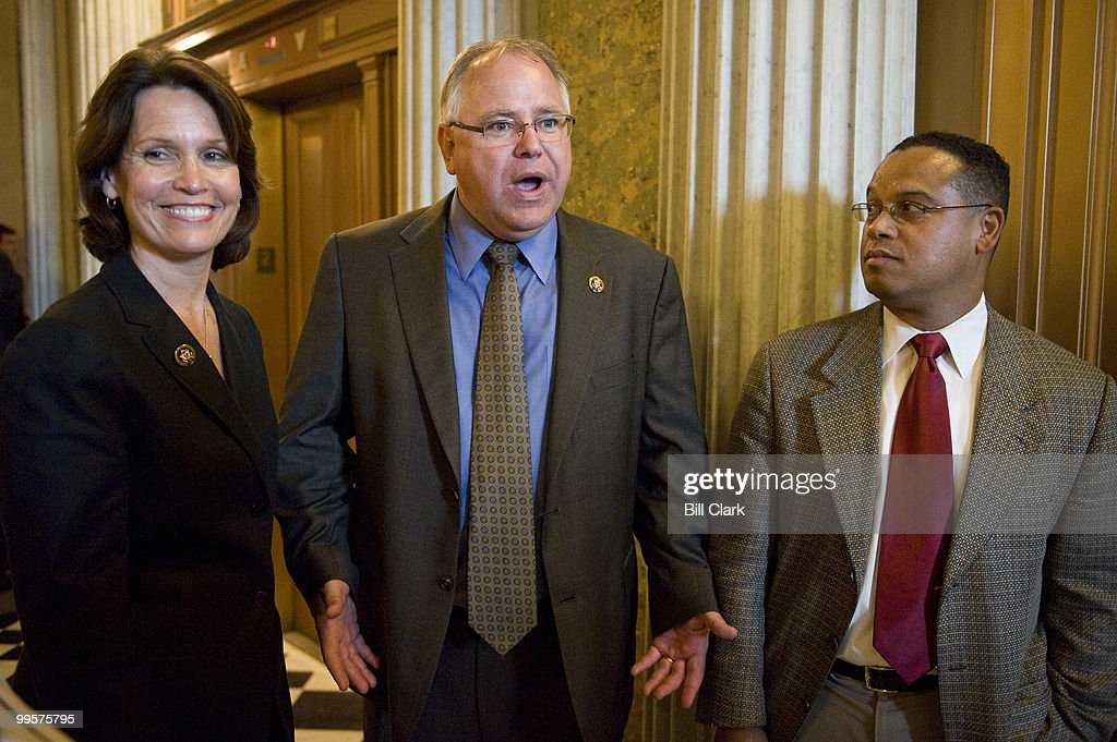 Minnesota House Democrats, from left, Rep. Betty McCollum, Rep. Timothy Walz, and Rep. Keith Ellison, wait for an elevator as they leave the Senate chamber following Sen. Franken's swearing-in ceremony on Tuesday, July 7, 2009.