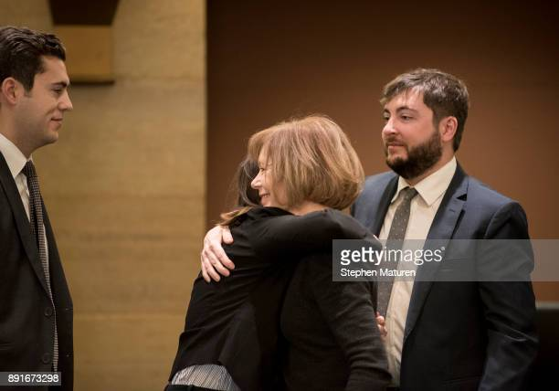 Minnesota Lt Governor Tina Smith embraces a family member after being introduced as the replacement to Senator Al Franken on December 13 2017 at the...