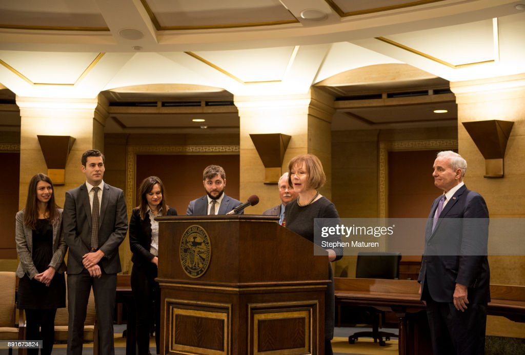 Minnesota Lt. Governor Tina Smith, flanked by her family and Governor Mark Dayton, fields questions after being named the replacement to Sen. Al Franken on December 13, 2017 at the Minnesota State Capitol in St. Paul, Minnesota. Franken resigned last week after multiple allegations of sexual harassment.