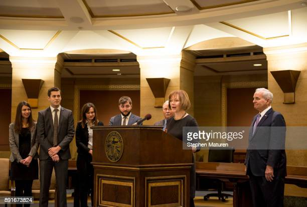 Minnesota Lt Governor Tina Smith flanked by her family and Governor Mark Dayton fields questions after being named the replacement to Sen Al Franken...