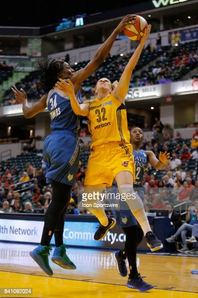 Minnesota Lynx center Sylvia Fowles blocks the shot of Indiana Fever guard Jeanette PohlenMavunga during the game between the Minnesota Lynx and...