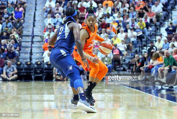 Minnesota Lynx guard Alexis Jones defends Connecticut Sun guard Alex Bentley during a WNBA game between Minnesota Lynx and Connecticut Sun on June 9...