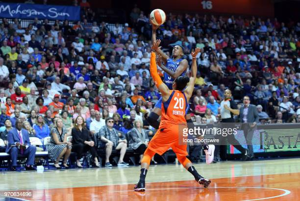 Minnesota Lynx guard Danielle Robinson shoots over Connecticut Sun guard Alex Bentley during a WNBA game between Minnesota Lynx and Connecticut Sun...