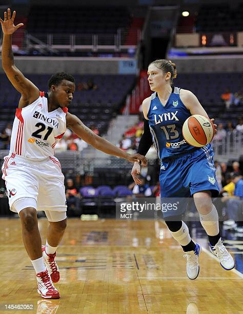 Minnesota Lynx guard Lindsay Whalen looks for space to work against the tight defense of Washington Mystics guard Natasha Lacy during thirdquarter...