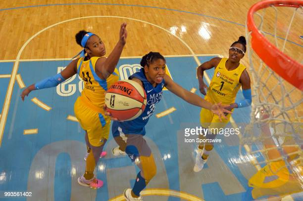 Minnesota Lynx guard Tanisha Wright shoots against Chicago Sky center Alaina Coates on July 7 2018 at the Wintrust Arena in Chicago Illinois