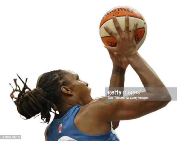 Minnesota Lynx vs Phoenix Mercury Target Center Minneapolis MN 7/24/13 Minnesota's Rebekkah Brunson drove to the basket as Phoenix's Jasmine James...