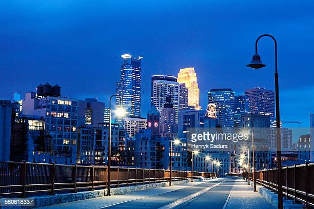 usa, minnesota, minneapolis, downtown district at night - minneapolis stock photos and pictures