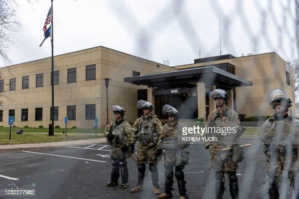 Minnesota National Guard and State Troopers stand guard outside the Brooklyn Center Police Station after a police officer shot and killed 20-year-old...