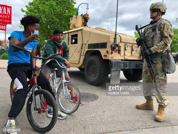 A Minnesota National Guard soldier patrols a street on May 29 2020 in Minneapolis Minnesota as protesters demand justice for George Floyd who died in...