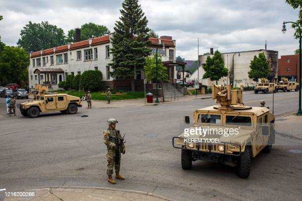 Minnesota National Guard soldiers patrol a street on May 29 2020 in Minneapolis Minnesota as protesters demand justice for George Floyd who died in...
