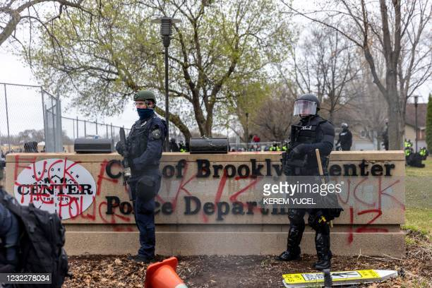 Minnesota Police stand guard outside the Brooklyn Center Police Station after a police officer shot and killed 20-year-old Daunte Wright during a...