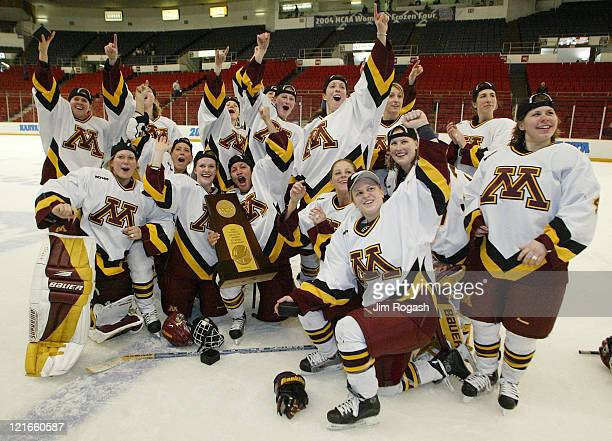 Minnesota poses for a team photo with the NCAA trophy after beating Harvard 6-2 at the final round of the NCAA 2004 Women's Frozen Four at the...