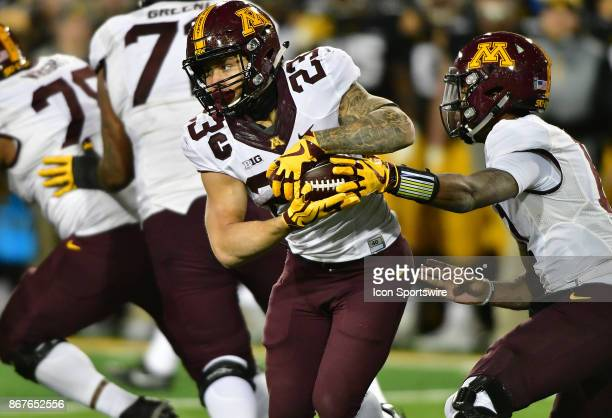 Minnesota quarterback Demry Croft hands off to Minnesota Gophers tailback Shannon Brooks during a Big Ten Conference football game between the...