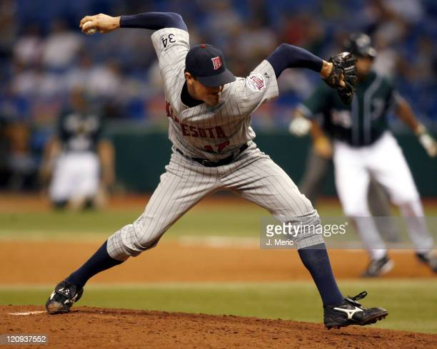 Minnesota relief pitcher Pat Neshek winds up during Wednesday night's game against Tampa Bay at Tropicana Field in St. Petersburg, Florida on...
