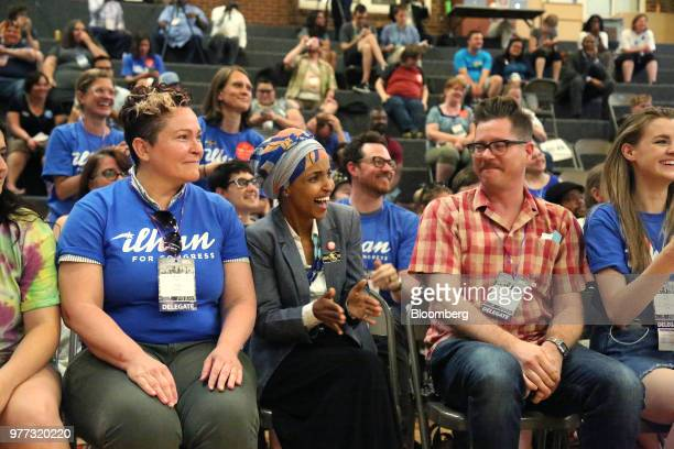 Minnesota Representative Ilhan Omar center celebrates after winning endorsement during the Democratic Farmer Labor Party convention in Minneapolis...