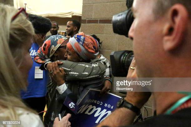 Minnesota Representative Ilhan Omar center right embrace an attendee after winning endorsement during the Democratic Farmer Labor Party convention in...