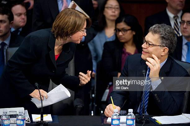 Minnesota Senators Amy Klobuchar and Al Franken talk during the Senate Judiciary Committee markup hearing of S598 the Respect for Marriage Act on...