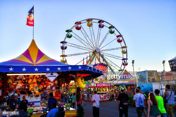 minnesota state fair midway games and rides - midway stock photos and pictures