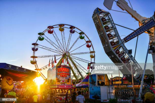 minnesota state fair midway rides and sun - midway stock photos and pictures