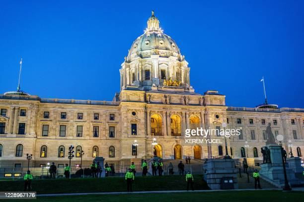 Minnesota State Patrol and National Guard soldiers stand in front of the Minnesota State Capitol building during a demonstration after the release on...