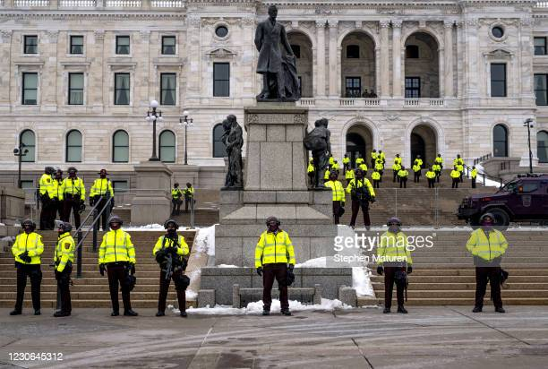 Minnesota State Patrol stand guard outside the Minnesota Capitol building on January 17, 2021 in St Paul, Minnesota. Supporters of President Trump...
