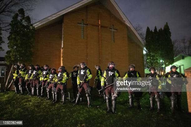 Minnesota State Troopers stand guard and hold a line as protests over police killing of Daunte Wright continue in Brooklyn Center, Minnesota, U.S.,...