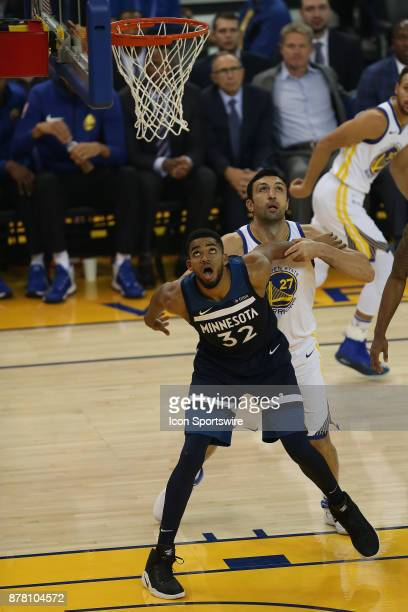 Minnesota Timberwolves center KarlAnthony Towns battles with Zaza Pachulia during an NBA game against the Golden State Warriors on November 08 2017...