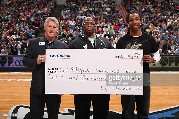 Minnesota Timberwolves Fast Break Foundation presents Larry Fitzgerald Sr and Larry Fitzgerald Jr of the Arizona Cardinals with a check for the Carol...