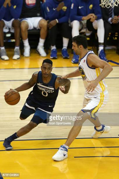 Minnesota Timberwolves guard Jeff Teague dribbles around Zaza Pachulia during an NBA game against the Golden State Warriors on November 08 2017 at...