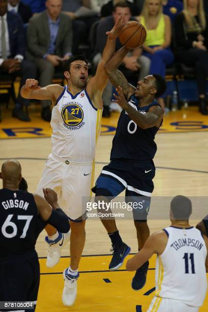 Minnesota Timberwolves guard Jeff Teague puts up a shot against the defense of Zaza Pachulia during an NBA game against the Golden State Warriors on...