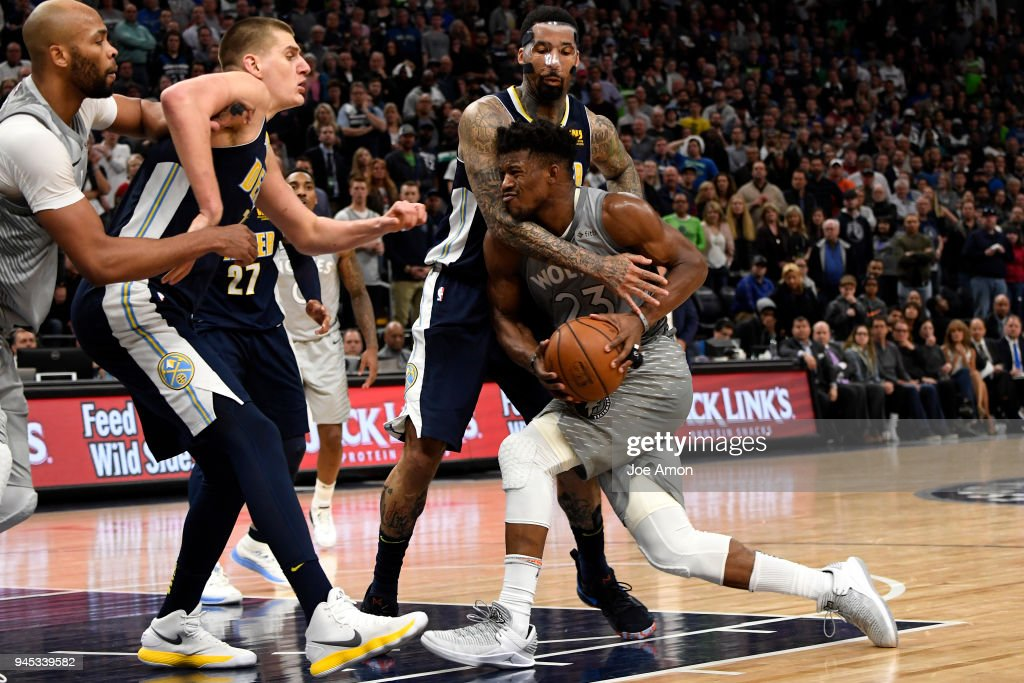 Minnesota Timberwolves guard Jimmy Butler (23) is fouled driving toward the basket in their overtime win over the Denver Nuggets in a winner-take-all regular-season finale 112 -106 at the Target Center in downtown Minneapolis. April 11, 2018 Minneapolis, Minnesota.