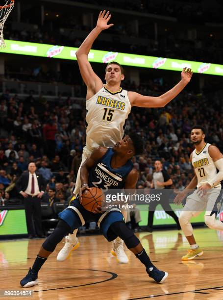 Minnesota Timberwolves guard Jimmy Butler looks to go up for a shot as Denver Nuggets center Nikola Jokic gets back on defense during the third...