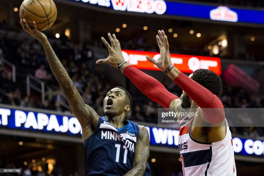 Minnesota Timberwolves Jamal Crawford (11) goes for a layup past Washington Wizards Mike Scott (30) at the Capital One Arena in Washington, USA on March 12, 2018. The Wizards lead the Timberwolves 59-53 at half time.