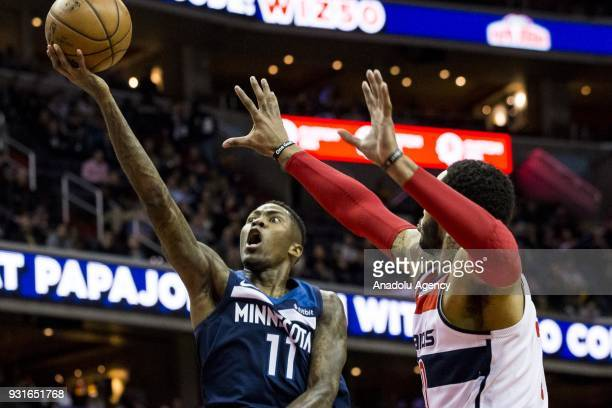 Minnesota Timberwolves Jamal Crawford goes for a layup past Washington Wizards Mike Scott at the Capital One Arena in Washington USA on March 12 2018...