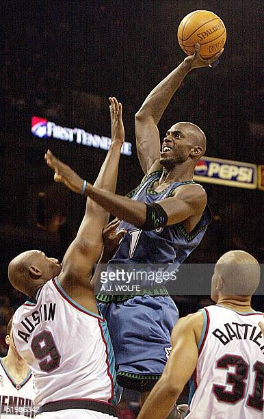 Minnesota Timberwolves' Kevin Garnett goes for a shot against the Memphis Grizzlies' Isaac Austin during the first quarter on 06 December 2001 at The...