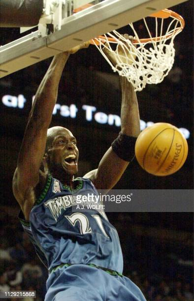 Minnesota Timberwolves' Kevin Garnett slams the ball in the first quarter against the Memphis Grizzlies 06 December 2001 at The Pyramid in Memphis...