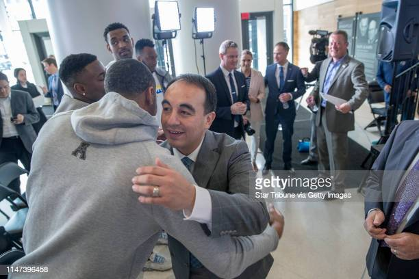 Minnesota Timberwolves new president of basketball operations Gersson Rosas was greeted by some of the Timberwolves players after a press conference...