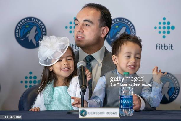 Minnesota Timberwolves new president of basketball operations Gersson Rosas addressed the media as his 3yearold twins Giana left and Grayson sat on...