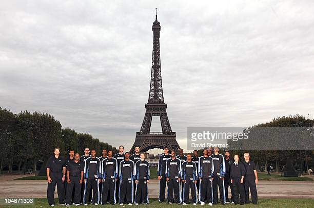 Minnesota Timberwolves players coaches and owner Glen Taylor pose for a team portrait in front of the Eiffel Tower during 2010 NBA Europe Live on...