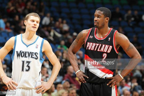 Minnesota Timberwolves point guard Luke Ridnour and Portland Trail Blazers guard Wesley Matthews looks on during the game against the Portland Trail...