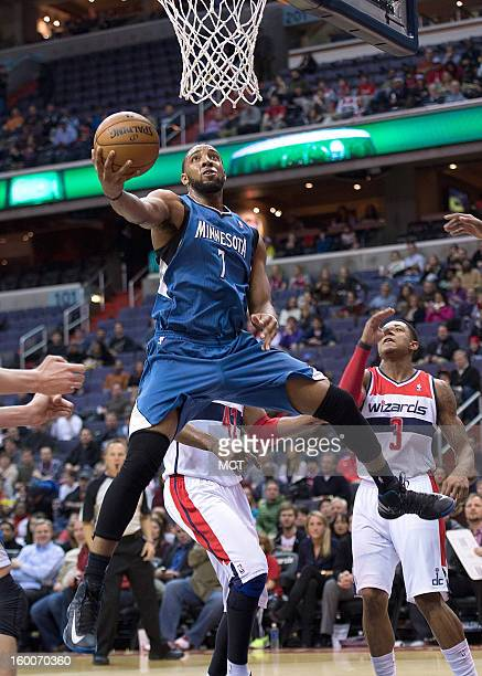 Minnesota Timberwolves power forward Derrick Williams scores after getting past Washington Wizards small forward Martell Webster during the first...