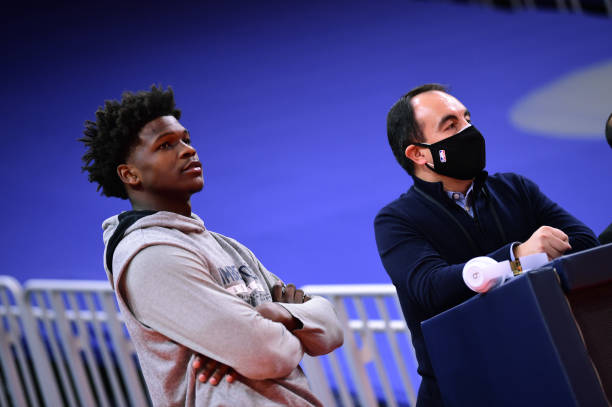 January 25: Minnesota Timberwolves President of Basketball Operations Gersson Rosas talks with Anthony Edwards before the game against the Golden...
